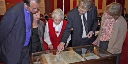 Thoroton Society members view historic Bible .