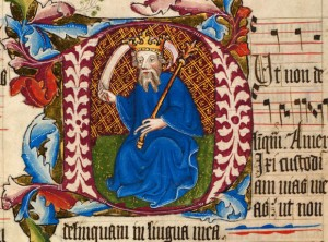 Historiated initial D showing David crowned holding a blank scroll, coloured with blues, red and gold leaf