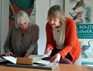 Janet Davies and Dorothy Johnston looking at manuscript