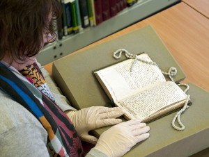 Examining Edward Wrench's diary in the Reading Room