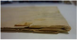 MS 281/1/15 showing how they were folded into bundles, and some of the damage at the edges.