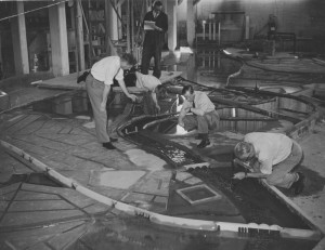 Photograph of technicians working with river flow model of the River Trent in Nottingham, c.1948 (Ref: RE/DOP/H36/39/1)