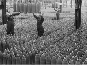 Female munitions workers guide 6 inch howitzer shells being lowered to the floor at the Chilwell ammunition factory in Nottinghamshire in July 1917. (Ref: Q 30040. Courtesy Imperial War Museum)