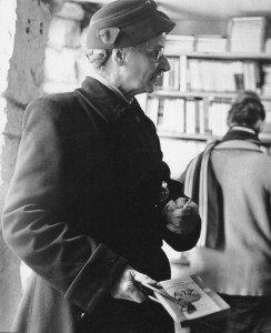 Photograph of a lady with 'Lady Chatterley's Lover', and match (Ref: For L 4/2/5)