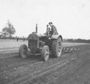 Agricultural students driving tractor, c.1948-1950