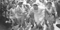 Students running in a fancy dress race, 1950