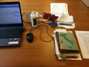 Photo of the laptop, archive supplies and pamphlets