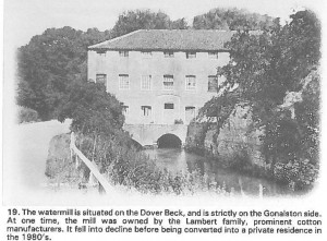 Black and white image of the mill taken from the road opposite the millpond