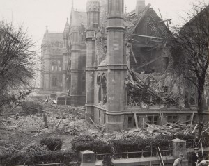 Photo of the exterior of the building showing one end partially collapsed as a result of bomb damage