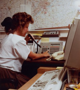 Photograph of a woman speaking into a microphone at the Severn Trent Water Customer Service Bureau, c.1989-1991