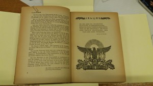Photo of a page from a Third Reich schoolbook showing German text and an image of the Imperial Eagle