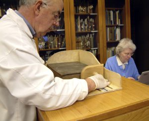 Volunteers measuring books in preparation for the department's move to King's Meadow Campus.