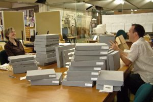 Sarah Colborne and Nick Dewhurst placing the measured books in their custom-made boxes.
