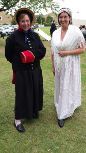 Debbie (r) brings her historical re-enactment hobby to work to promote a Napoleonic War-themed exhibition in 2015.