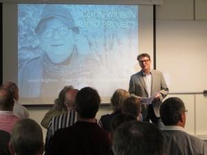Photo of Simon Brighton speaking to the audience