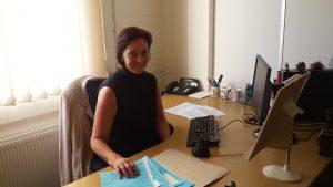 Debbie in the office processing customer copying orders