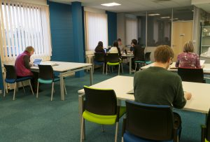 Researchers in the recently-refurbished Reading Room at King's Meadow