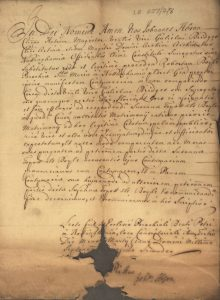 Handwritten Latin document with a hole at the bottom caused by rodents
