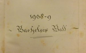 Swirly handwriting on the opening page for the 1908-9 Bachelors Ball