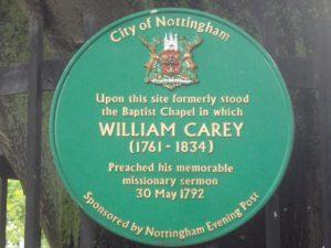 Round green plaque on railings. . Copyright Jez Nicholson https://www.flickr.com/photos/jnicho02/albums/72157624076156279