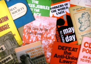 Close up of the covers of pamphlets mainly relating to workers' rights