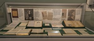 Photo of one of the cases in the Collected Words exhibition with a range of papers and books on display