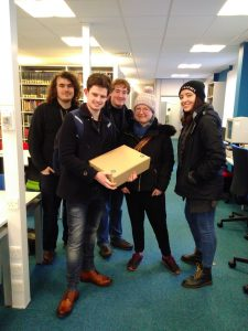Five students in the Reading Room with a box of archives