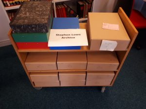 Trolley loaded with archive boxes