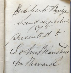 Handwritten dedication of a book awarded as a Sunday School prize in 1875