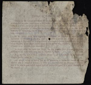 Reverse of the dog licence with printed rules nearly unreadable due to the poor condition of the document