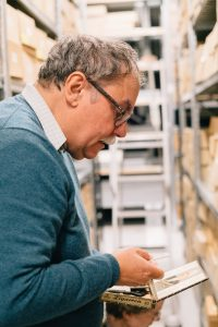 Professor Peter Morris on a recent visit to MSC, looking at items from the Peter Mansfield collection in the archive store
