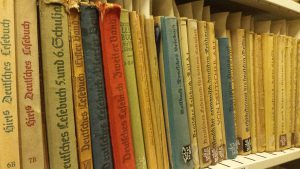 A shelf of books with German titles printed in Fraktur font
