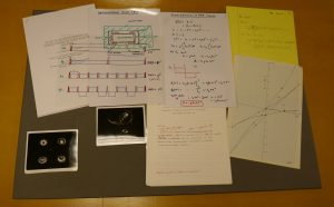 Display of papers, technical drawings, printed MRI scans and letters