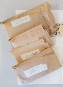 Sorted and catalogued clippings in their envelopes
