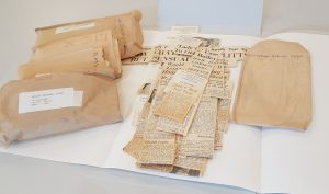 Newspaper clippings and the envelopes they were filed in