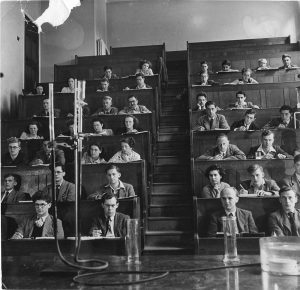 Students seated in a lecture theatre watching a science experiment , Trent Building, 1948 (UMP/1/13/33)
