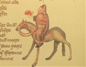 Copy image from a medieval manuscript, a clerk in a brown habit riding a horse with red saddle and reigns. Some handwritten text just visible on the left of the image.