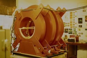 Colour image of the enormous (room sized) trio of magnet coils that would be inside the MRI.