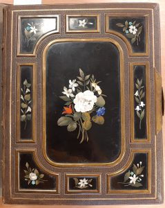 Bound volume with floral decorated enamelled boards