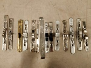 A selection of metal clips and fastenings removed from the lever arch folders.