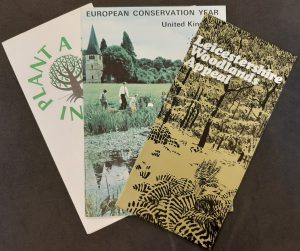 Trio of folded pamphlets splayed out to show the coloured images of trees on the covers.