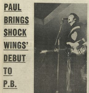 """Article from student newspaper with headline """"Paul brings shock Wings debut to Portland Building', and includes a photograph of Paul McCartney on stage"""