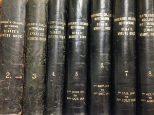 Photograph of the spines of bound minutes of University College Nottingham