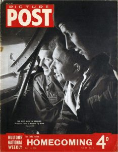 Black and white photograph showing three former Allied PoWs looking out of a plane window with joy.