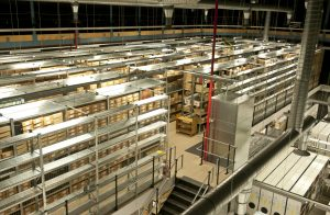 Photograph of the Manuscripts and Special Collections store showing full and empty shelves