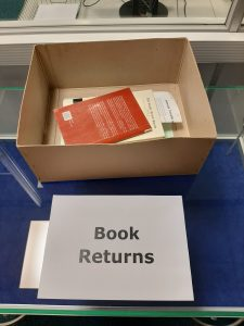 Box with a couple of books in it labelled Book Returns