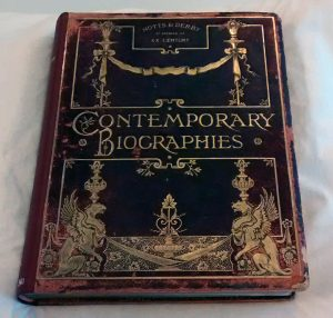 Leather cover with red rot around the edges, lots of gold and gilt decoration on the cover, title 'Contemporary Biographies' also in gold.