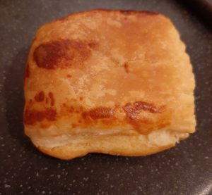 Close up of a cooked cheese roll