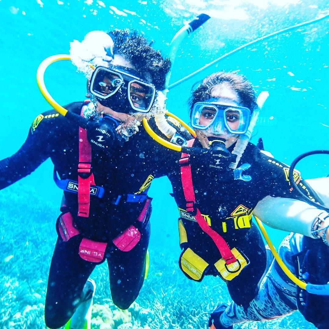 Dr Arjunaa Wimalathasan scuba diving in Australia