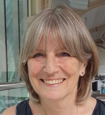 Dr Lindsey Davies smiling at the camera